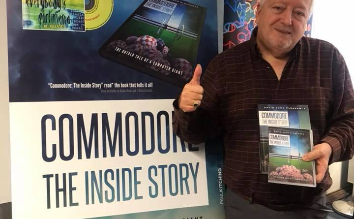 David Pleasance holding his new book
